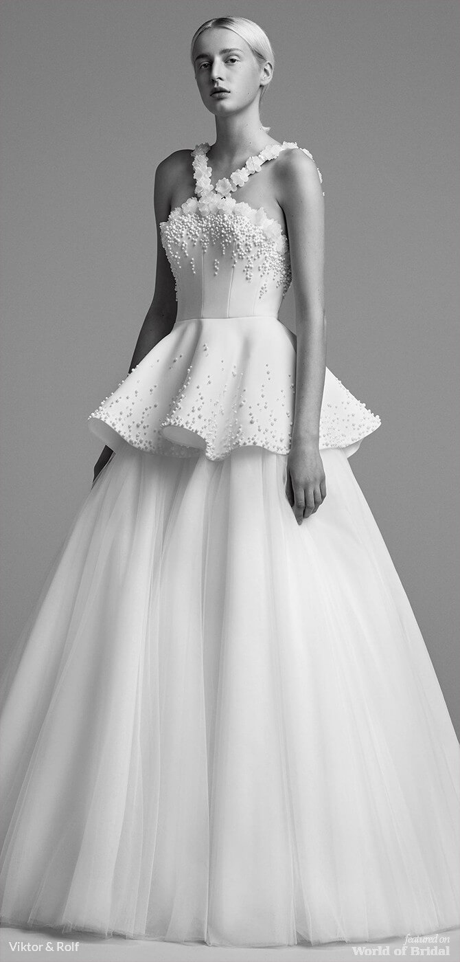 3e5bd92fdf9 Viktor   Rolf Fall 2018 Embellished iced flower peplum bridal gown  featuring a playful embellished peplum. The bodice is adorned with iced  flowers ...