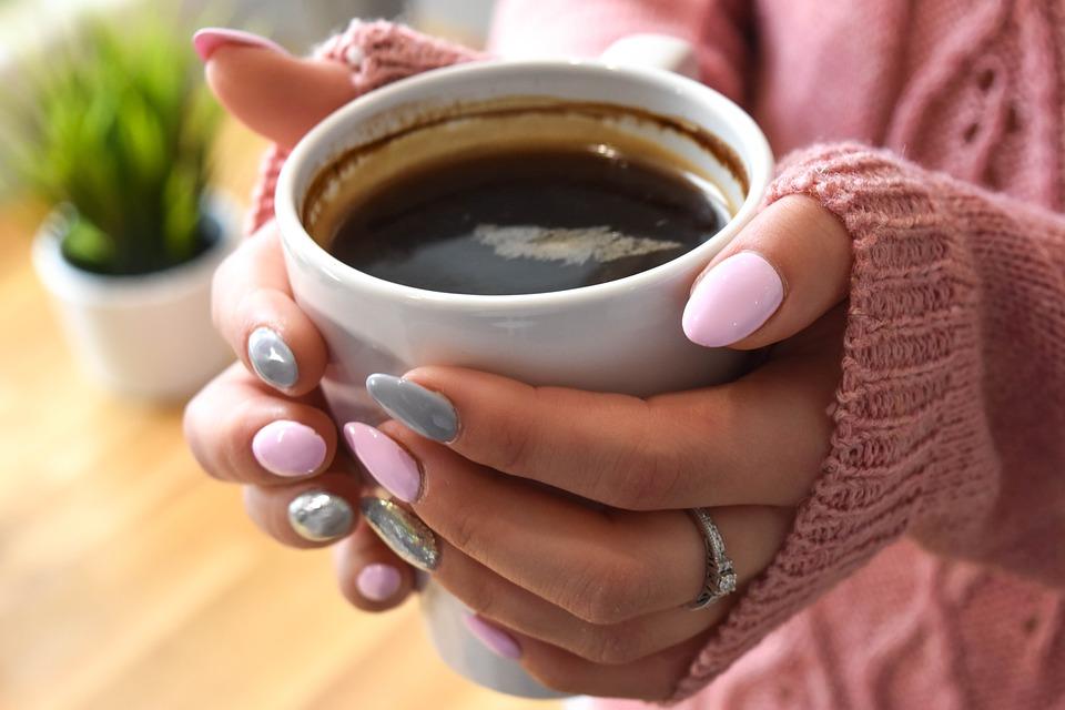 polished-nails-holding-coffee.jpeg