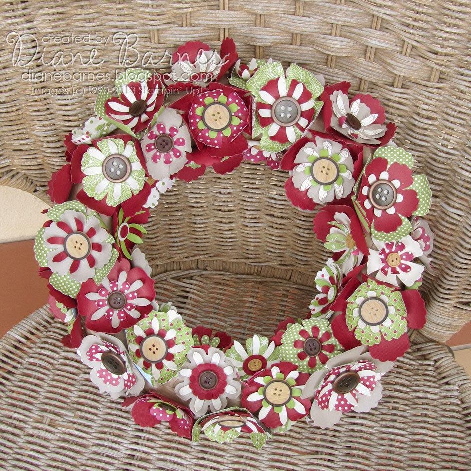 Colour me happy flower christmas wreath we started off by covering a flat backed polystyrene ring with the brown paper that comes with our su orders then we die cut lots of flowers in card dsp mightylinksfo