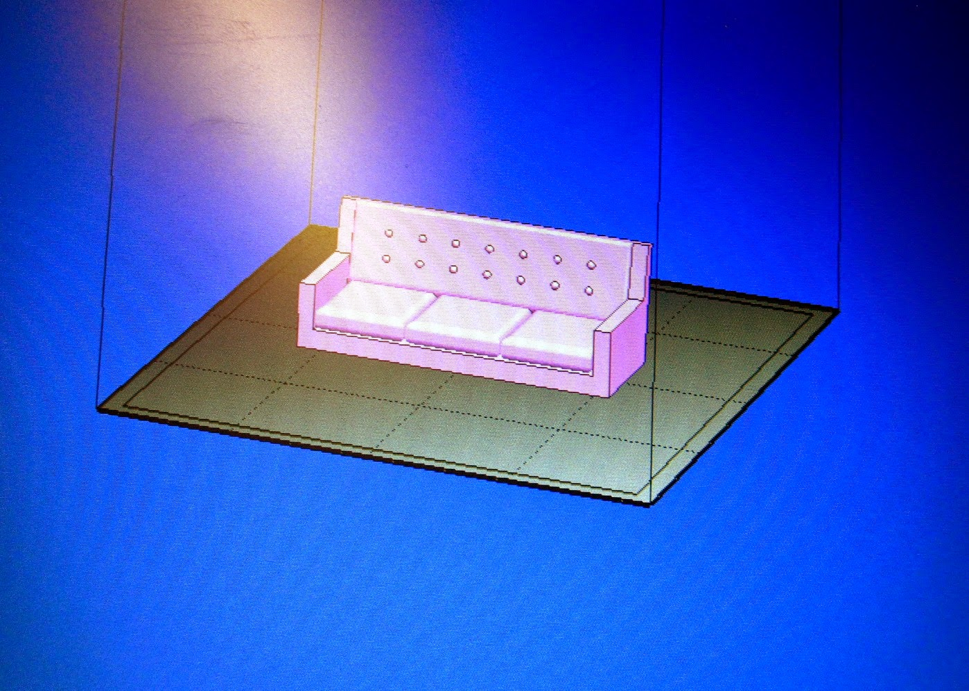 Computer screen showing a miniature 3D printed sofa from Thingiverse.