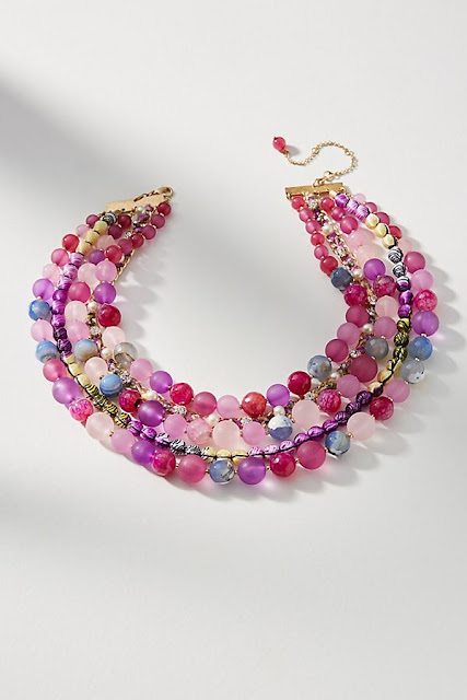 When I think of jewelled tone colours this necklace is exactly what I had in mind. There are so many tonal shades of pink, purple and blue beads in this lovely statement necklace. Statement necklaces have been less popular in recent years but this has something quite ageless about it. I especially love the detail of the extra bead on the end of the chain extension.