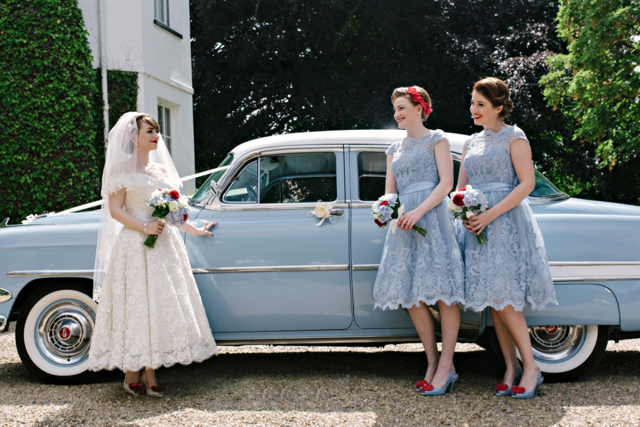 Vintage 50s car with bride and bridesmaids