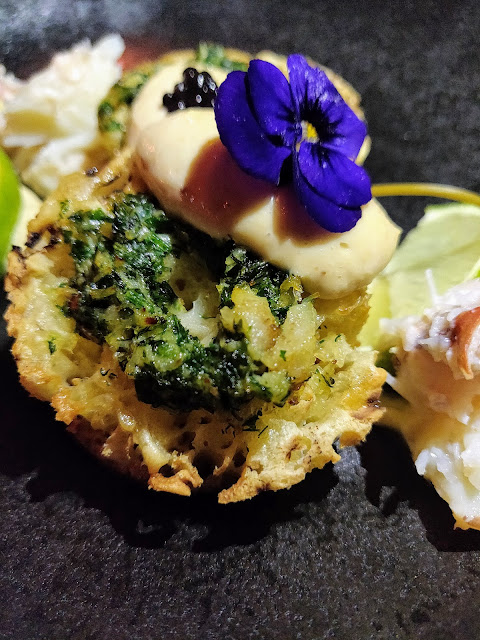 smoked cod roe with crab butter on a crumpet, topped with caviar.Iron Bloom menu