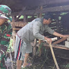 Anggota Satgas TMMD ke 104 Kodim 0417 /Kerinci Bantu bersihkan kandang ternak warga