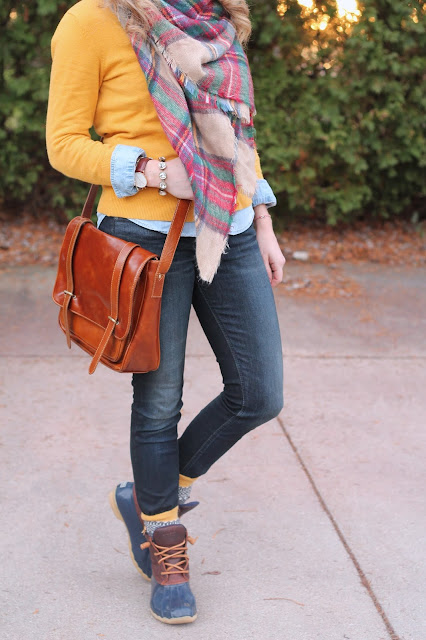 silver jeans, chambray, mustard cardigan, blanket scarf, red beanie, duck boots, cognac bag