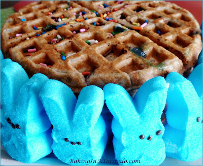 Springtime Waffles, the colors of spring add to the fun of these waffles with some surprise ingredients. For Easter or any occasion. | Recipe developed by www.BakingInATornado.com | #recipe #breakfast #Easter