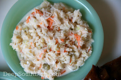A basic cabbage coleslaw with a creamy vinegar and mayonnaise base.