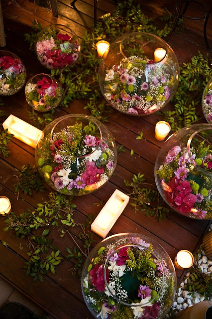 floral wedding fish bowl decoration with candles and flowers and  plants