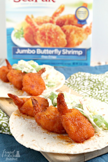 Crispy breaded shrimp are tossed in a homemade honey buffalo sauce & then wrapped up in warm flour tortillas with a creamy Ranch coleslaw in these Honey Buffalo Butterfly Shrimp Tacos.