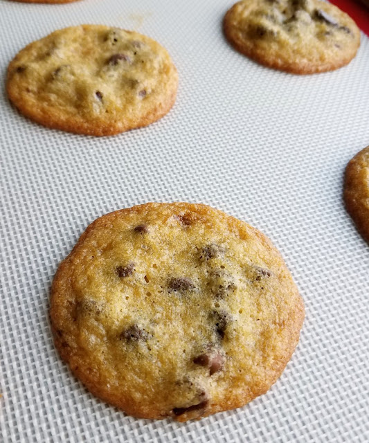 Fresh baked salted chocolate chip cookies on silicone baking mat