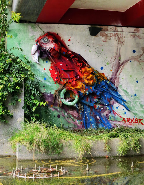 This vibrant Macaw is the last Street Art Installation By Bordalo II Somewhere in Portugal. 1