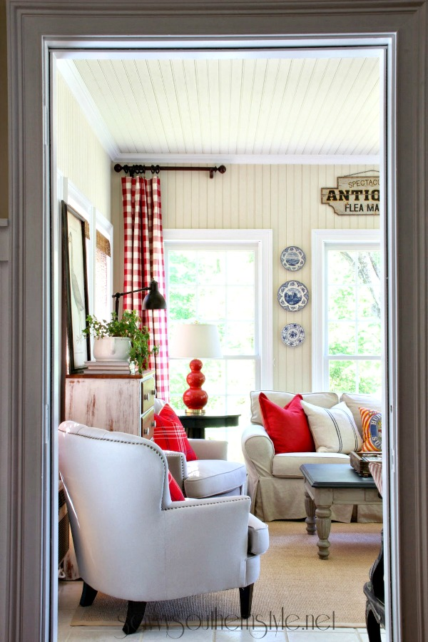 Fun spring sun room with buffalo check drapes and farmhouse style touches