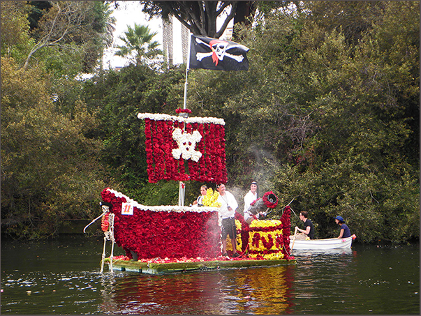 dark red pirate ship with yellow, pirate flag and exploding begonia cannon