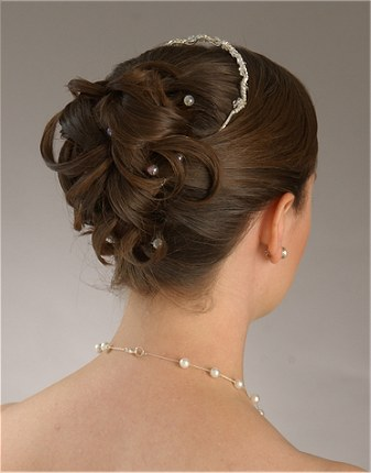 modern wedding hairstyles with bun paola pozzessere