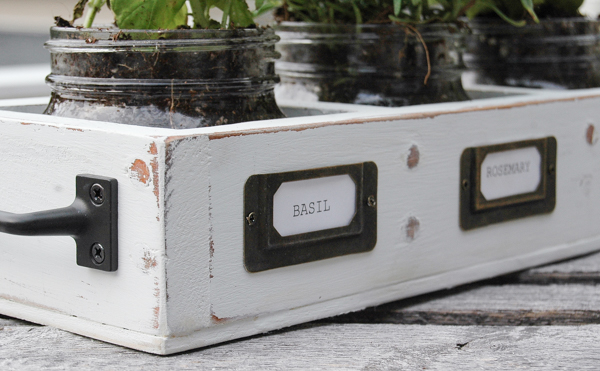 A dated shelf gets turned into a perfectly rustic farmhouse herb garden. www.littlehouseoffour.com