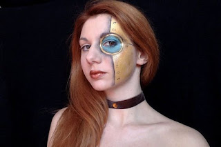 Steampunk special fx makeup for halloween or cosplay. Gold robot with rivets, and blue monocle.