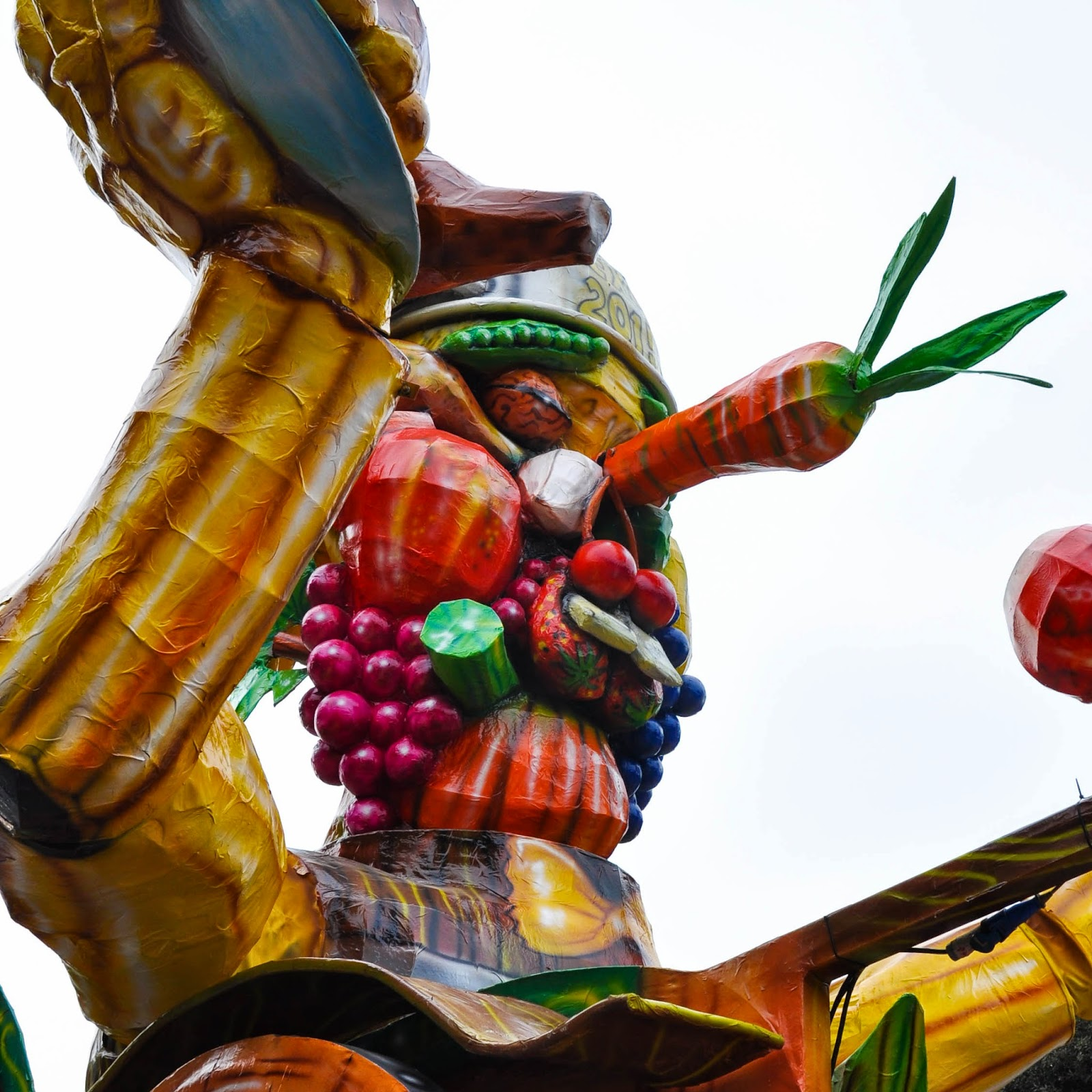 A papier mache figure fashioned after an Arcimboldo painting