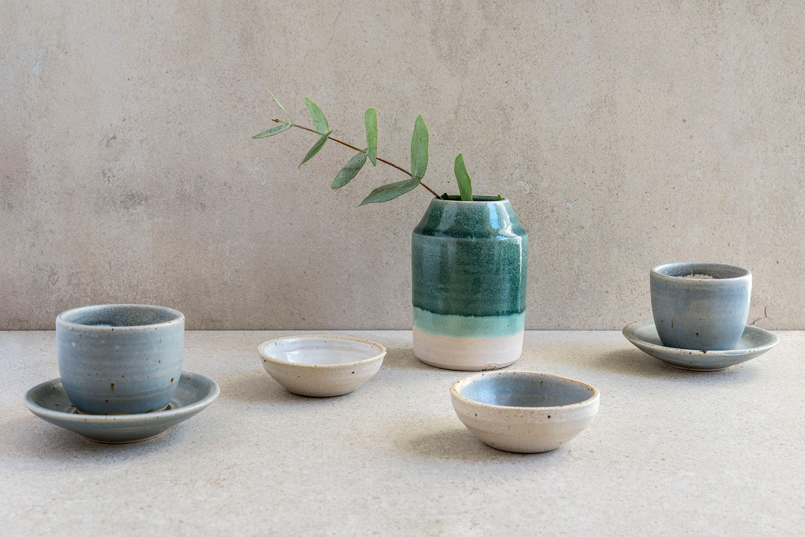 Calming colours of Liz Vidal's hand thrown cups, saucers, bowls and vase.