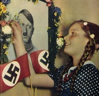 German girl with portrait of Adolf Hitler, color photos worldwartwo.filminspector.com