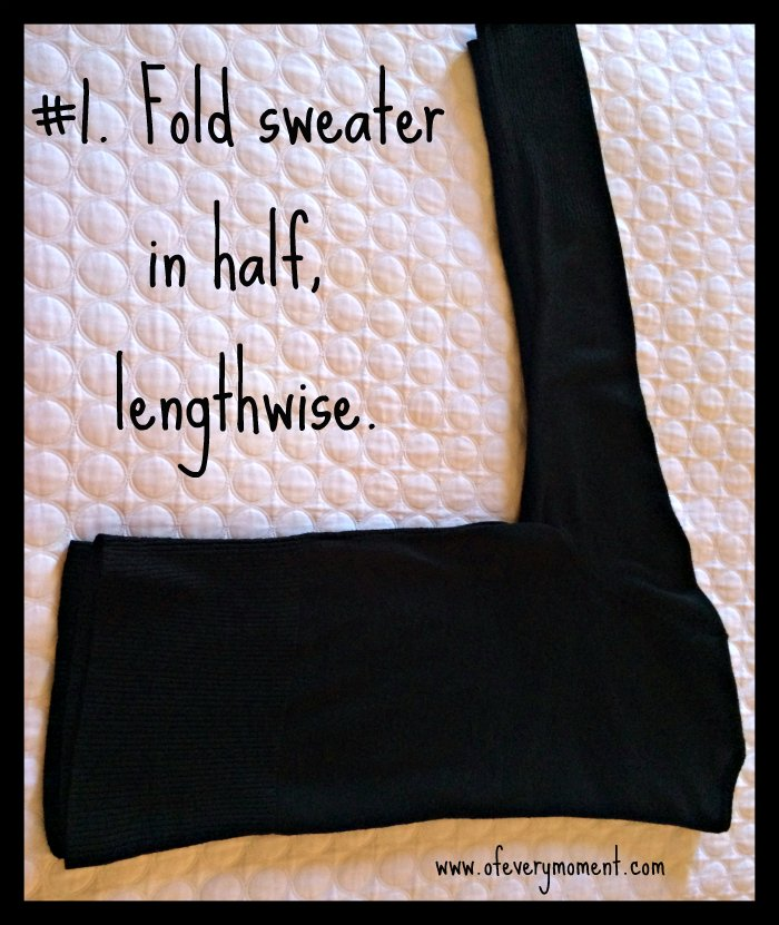 Hanging a sweater: step 1.  Fold in half lengthwise.