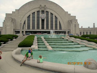 Cincinnati Union Terminal Museum Center exterior showing art deco design in face of building and flowing waterfall and pond
