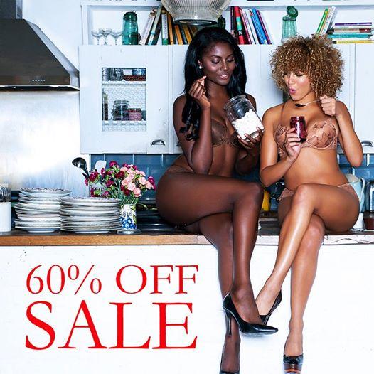 2 sistahs sitting on a counter in kitchen wearing Nubian Skin undergarments