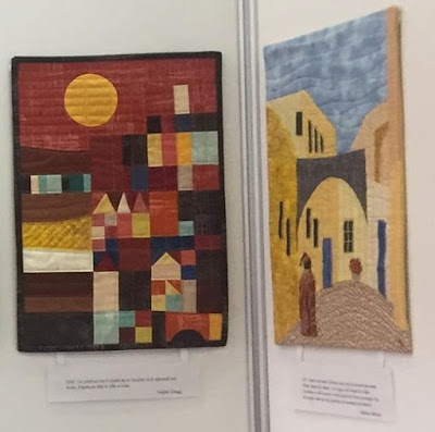 Luna Lovequilts - My quilt La ville au loin and Martine Mercier's quilt hanging at BIAT 2018