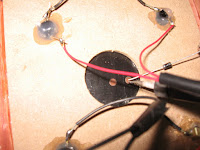 Solder the diode to the negative terminal of the solar cell