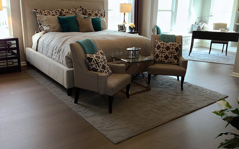 Darker hardwood floor in a bedroom adds warmth and beauty