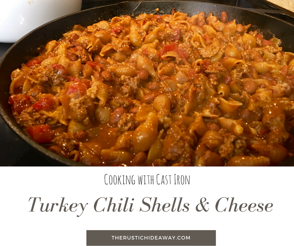 Image of cast iron skillet filled with turkey choli shells and cheese