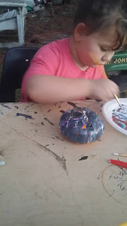 toddler painting pumpkins for halloween, oh what fun it is, historic pumpkin day