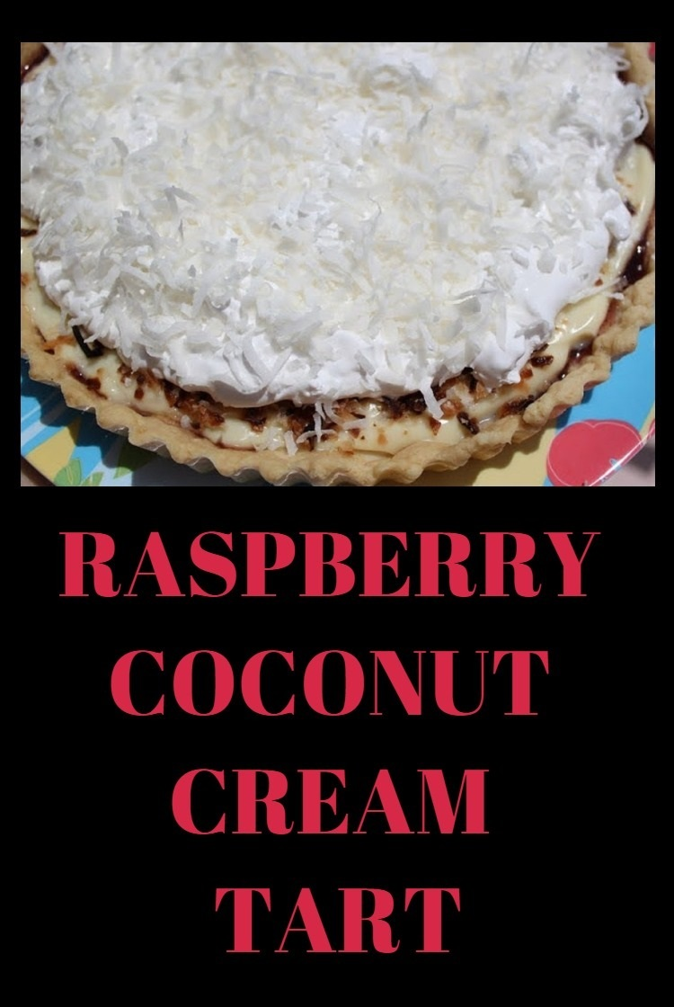 Raspberry cream tart with coconut cream filling, triple berry sauce and cream in a homemade tart shell