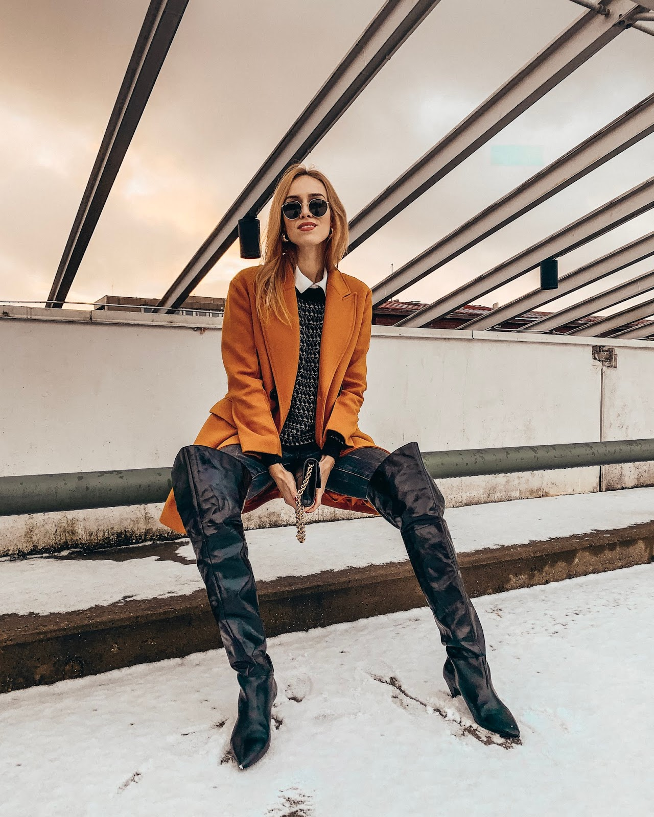 yellow wool coat over knee leather boots sweater jeans winter outfit