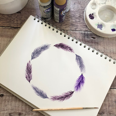 Purple feathers painted in a wreath. Learn how with You Can Folk It