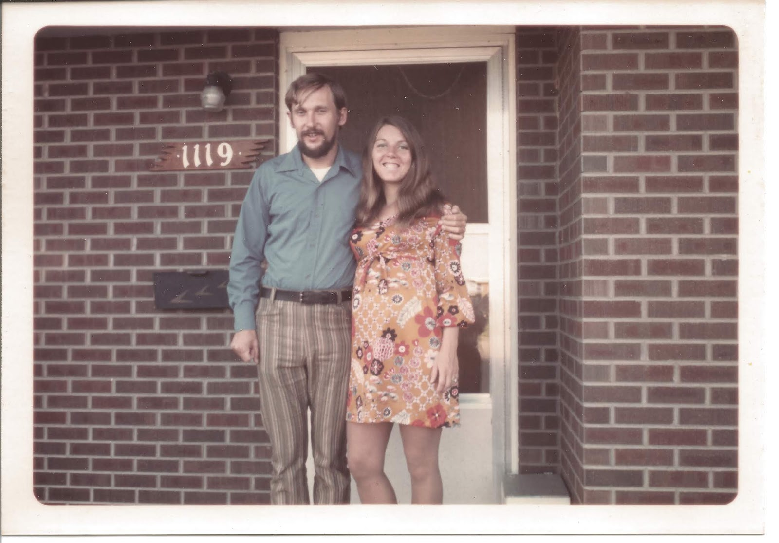 couple in front of house circa 1970's