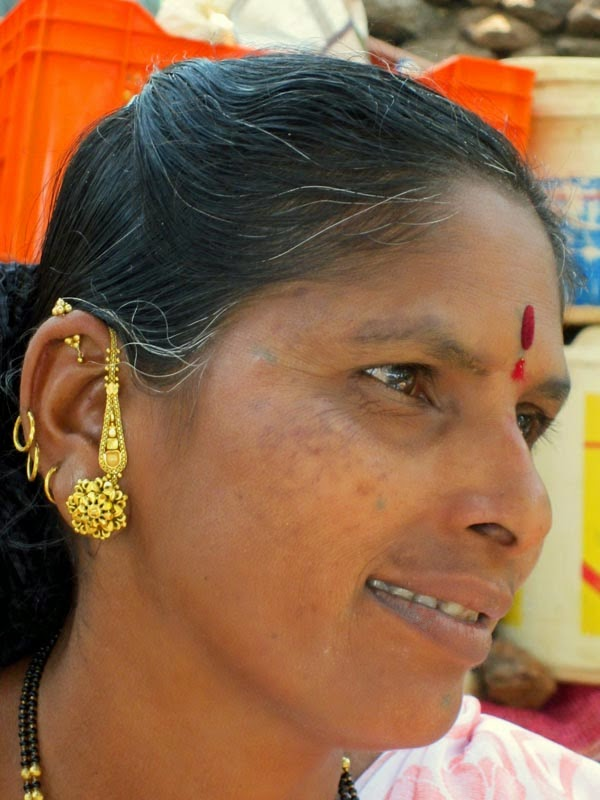 Woman with gold earrings