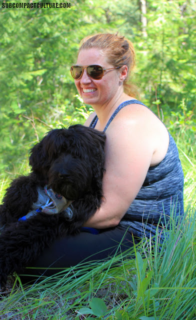 Ladies' off-road class attendee, along with her playful puppy dog.