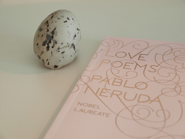 Love Poems by Pablo Neruda and quail egg. Photo by Hello Lovely Studio