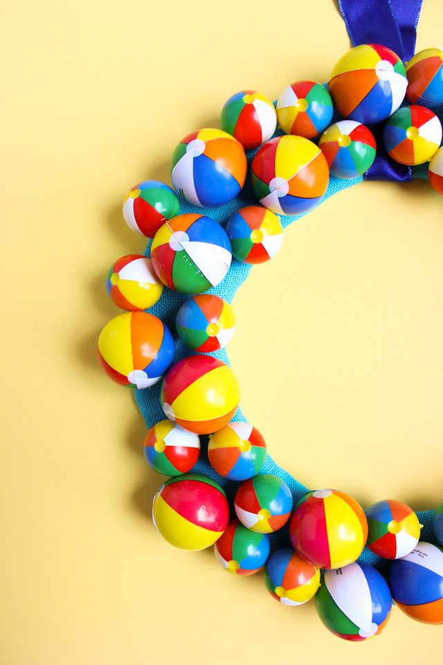 This wreath screams summer! Use mini beach balls to create a fun summer wreath for your front door or pool party!
