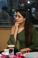 Pragya Jaiswal in a single Sleeves Off Shoulder Green Top Black Leggings promoting JJN Movie at Radio City 10.08.2017 027.JPG