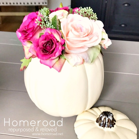Faux pumpkin with flowers centerpiece