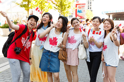 Chinese in Canada waving Canadian flag