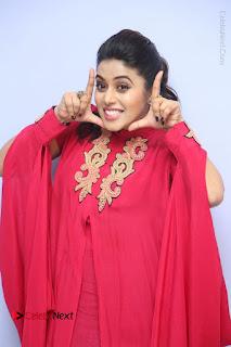 Actress Poorna Latest Stills in Red Dress at Rakshasi First Look Launch  0102.JPG
