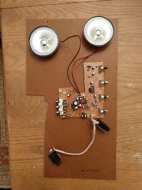 "The initial salvage: main circuit board, speakers, and 1/4"" input jacks."