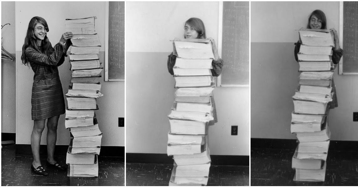 Margaret Hamilton Poses Next to a Huge Stack of Code She Wrote by Hand That Took Humanity to the Moon in 1969