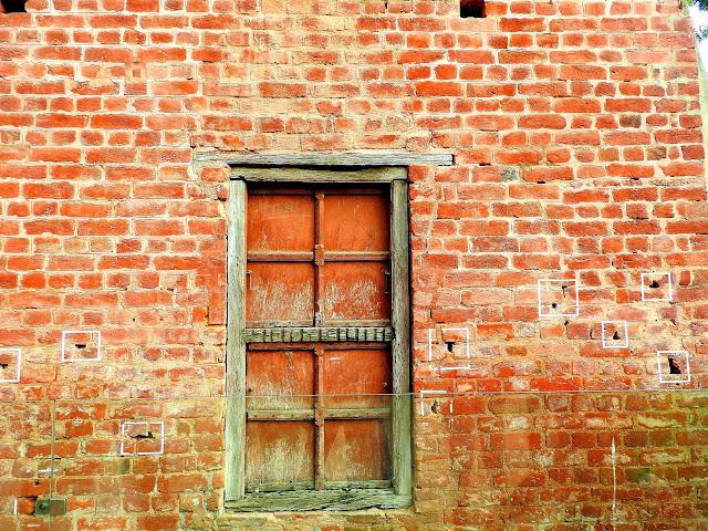 Bullet holes in the wall dating back to 1909 | Jallianwalla Baug massacre | Amritsar, Punjab (April 2016)