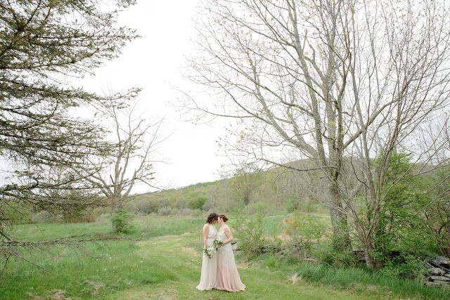 Jonna and Heather in the yard at their Inn at West Settlement Wedding by Karen Hill Photography