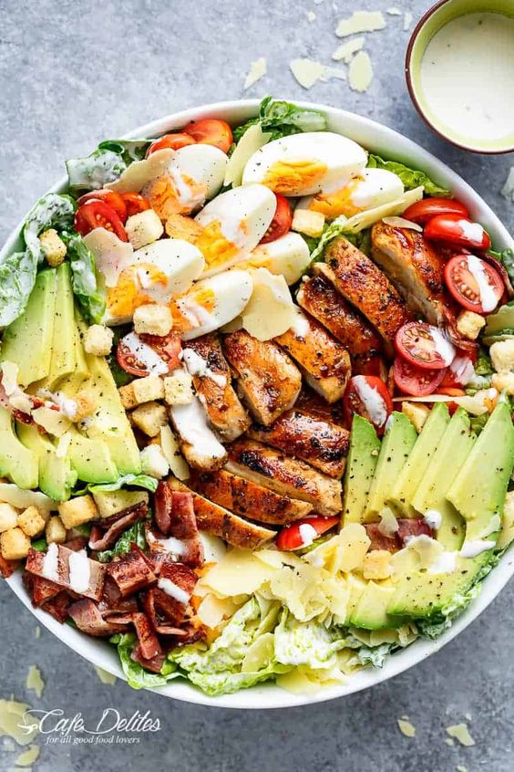 Grilled Chicken Cobb Caesar Salad is a meal in a salad, mixing two of your favourites into one delicious bowl! Perfect for lunch OR dinner!