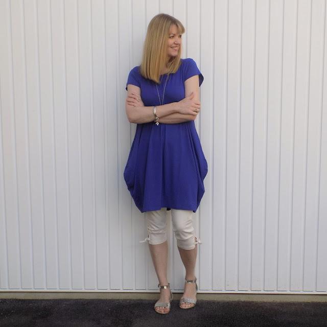cobalt blue Masai balloon dress ad pirate trousers