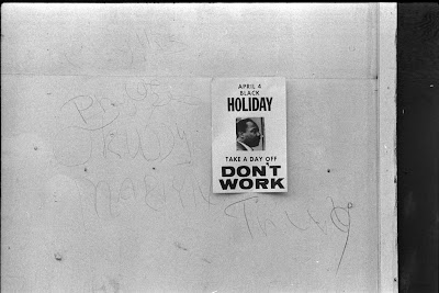 sign promoting a holiday to honor the anniversary of the assassination of Martin Luther King, Jr.